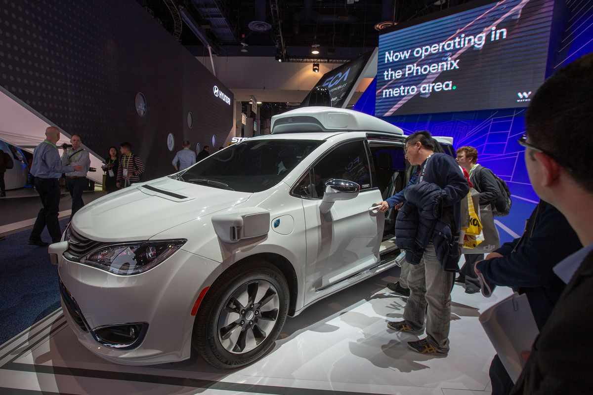 People look at the Waymo car, formerly the Google self-driving car project, during the Consumer Electronics Show 2019 in Las Vegas. | David McNew/AFP/Getty Images