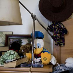 Joe Ortega's nightstand is covered with books, family photos and stuffed animals in his studio apartment at Grace Mary Manor in South Salt Lake on Friday, Dec. 9, 2016. Ortega was living on the streets for 20 years until Ed Snoddy convinced him to get sober. Grace Mary Manor provides permanent supportive housing for chronically homeless people with a disabling condition.