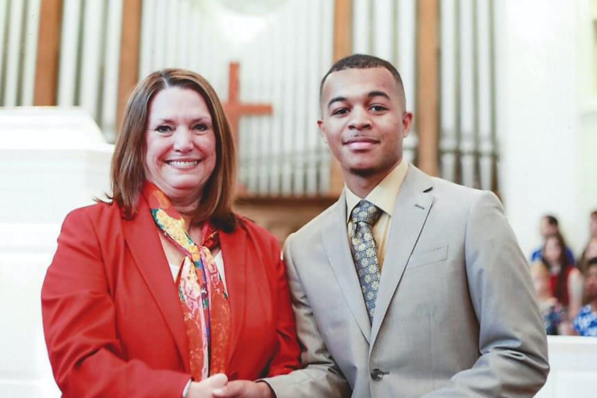 Barbara Harmon, left, poses with a Germanton High School student. Hamon is up for Tennessee's principal of the year.