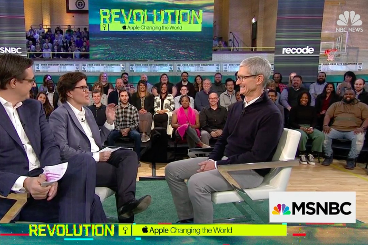 """Chris Hayes of MSNBC, Kara Swisher of Recode and Tim Cook of Apple onstage at the """"Revolution"""" event in Chicago"""