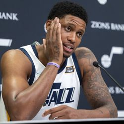 Utah Jazz forward Rudy Gay (8) touches his face as he talks during the Utah Jazz media media day at Vivint Arena in Salt Lake City on Monday, Sept. 27, 2021.