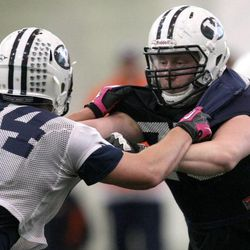 Micheal Doman (#94) and Brad Wilcox practice with the BYU football team during spring practice at BYU in Provo on Friday, March 22, 2013.