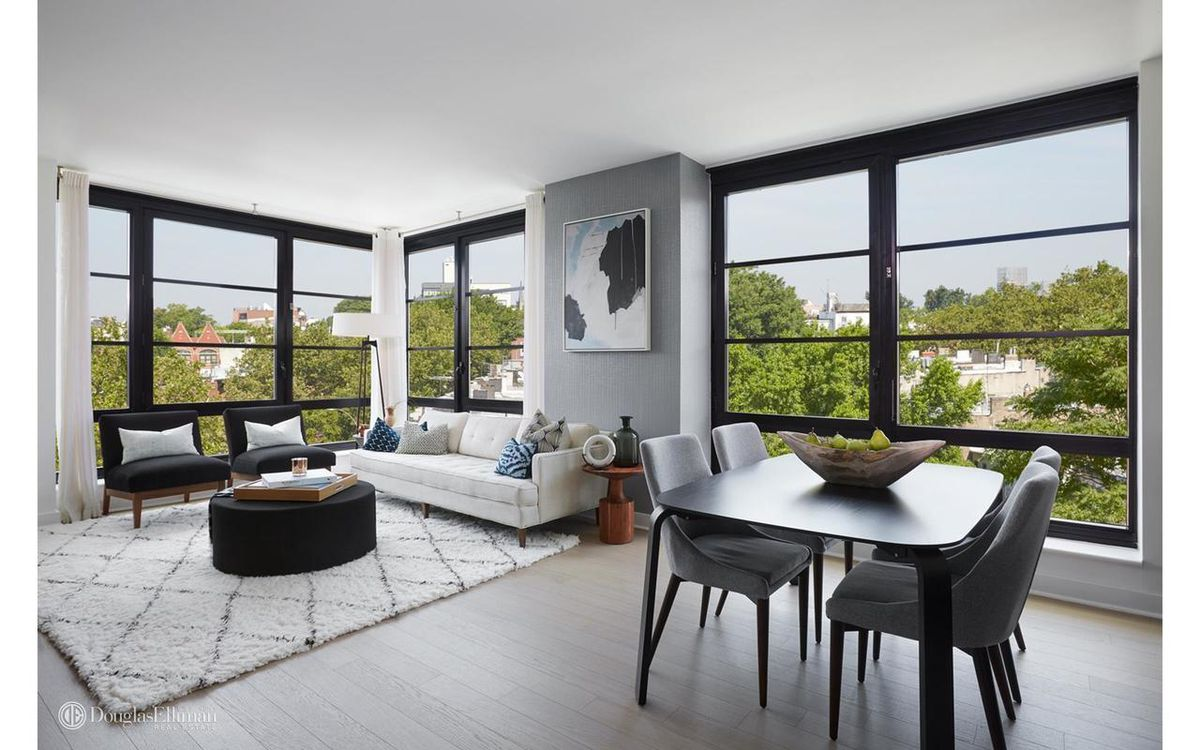 The Apartment Embraces That Chic Look With An Open Living Dining Room Oak Wood Floors And Floor To Ceiling Cat Windows