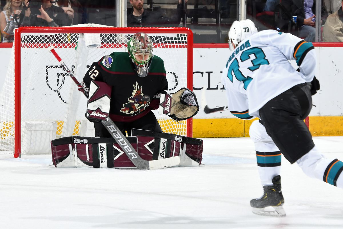 Goalie Antti Raanta #32 of the Arizona Coyotes positions himself for a save on the shot by Noah Gregor #73 of the San Jose Sharks during the second period of the NHL game at Gila River Arena on November 30, 2019 in Glendale, Arizona.