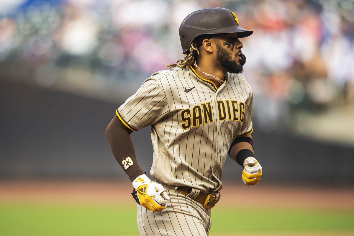 Fernando Tatis Jr. of the San Diego Padres jogs around the bases after hitting a home run in the seventh inning against the New York Mets at Citi Field on June 12, 2021 in the Queens borough of New York City.