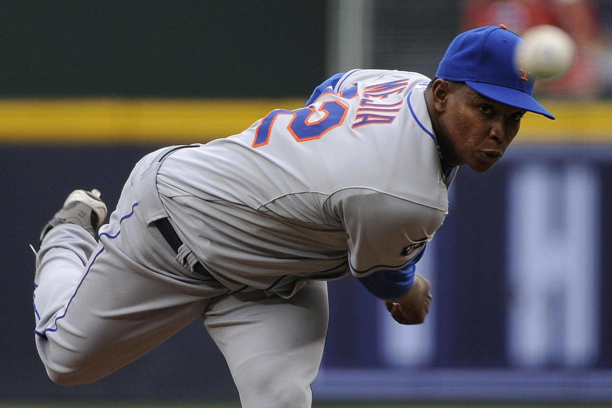 New York Mets pitcher Jenrry Mejia delivers to the Atlanta Braves during the first inning of their baseball game at Turner Field Sunday, Sept. 30, 2012, in Atlanta.