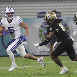 Brigham Young Cougars wide receiver Dax Milne (5) runs for a gain during the Boca Raton Bowl in Boca Raton, Fla., on Tuesday, Dec. 22, 2020.