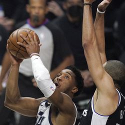 Utah Jazz guard Donovan Mitchell, left, shoots as Los Angeles Clippers forward Nicolas Batum defends during the first half in Game 6 of a second-round NBA basketball playoff series Friday, June 18, 2021, in Los Angeles.