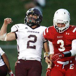 Jordan's Austin   Kafentzis  celebrates his touchdown by East's Niel Robbins  in Salt Lake City  Friday, Aug. 31, 2012.