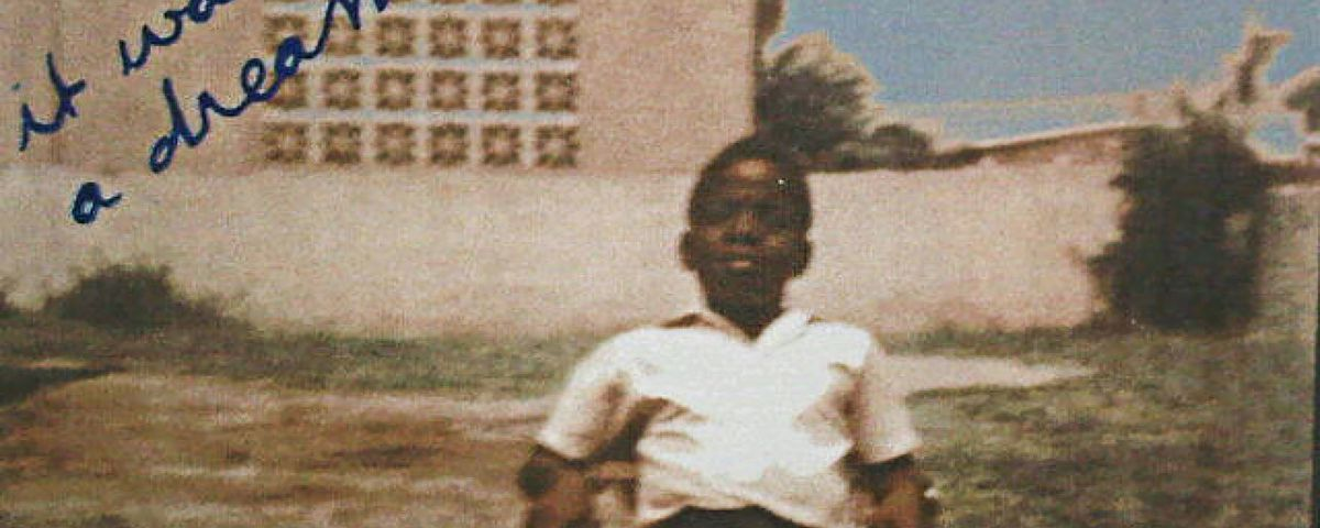 A photo of a young Christopher Wallace sitting outside in a chair.