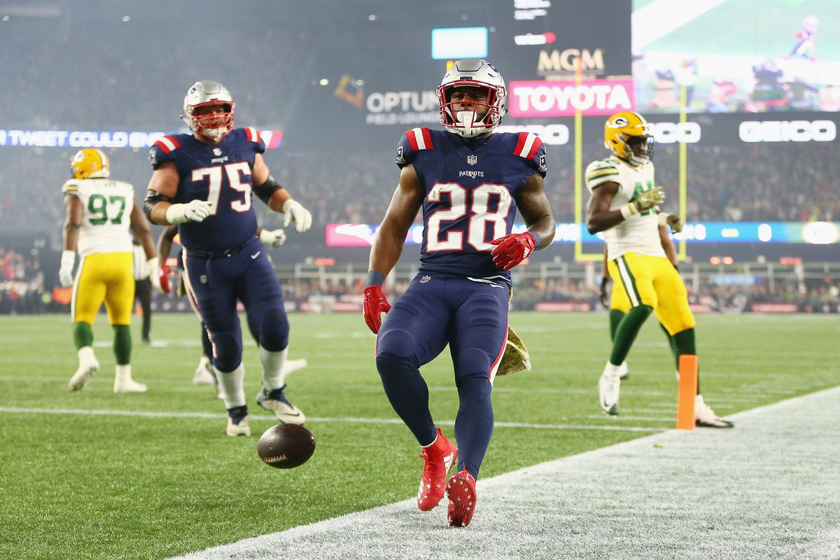 James White #28 of the New England Patriots rushes for an 8-yard touchdown during the first quarter against the Green Bay Packers at Gillette Stadium on November 4, 2018 in Foxborough, Massachusetts.