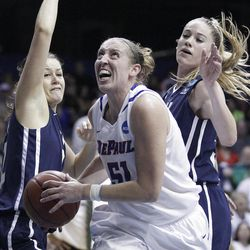 DePaul forward Katherine Harry (51) drives to the basket against BYU forward Dani Peterson (32), left, and forward Kristen Riley (35) during the second half of an NCAA tournament first-round women's college basketball game in Rosemont, Ill., Saturday, March 17, 2012. DePaul won 59-55. (AP Photo/Nam Y. Huh)