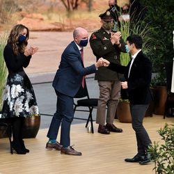 """New Utah Gov. Spencer Cox fist bumps David Archuleta after Archuleta and Nathan Pacheco sang """"Homeward Bound"""" during the inaugural event at Tuacahn Center for the Arts in Ivins near St. George on Monday, Jan. 4, 2021."""