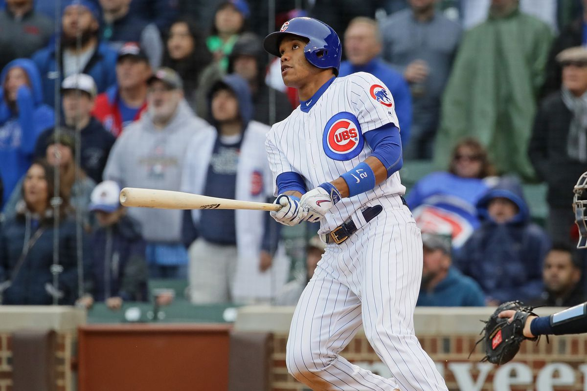 CHICAGO, IL - APRIL 19:  Addison Russell #27 of the Chicago Cubs hits a three run, walk-off home run in the bottom of the 9th inning against the Milwaukee Brewers at Wrigley Field on April 19, 2017 in Chicago, Illinois. The Cubs defeated the Brewers 7-4.  (Photo by Jonathan Daniel/Getty Images)