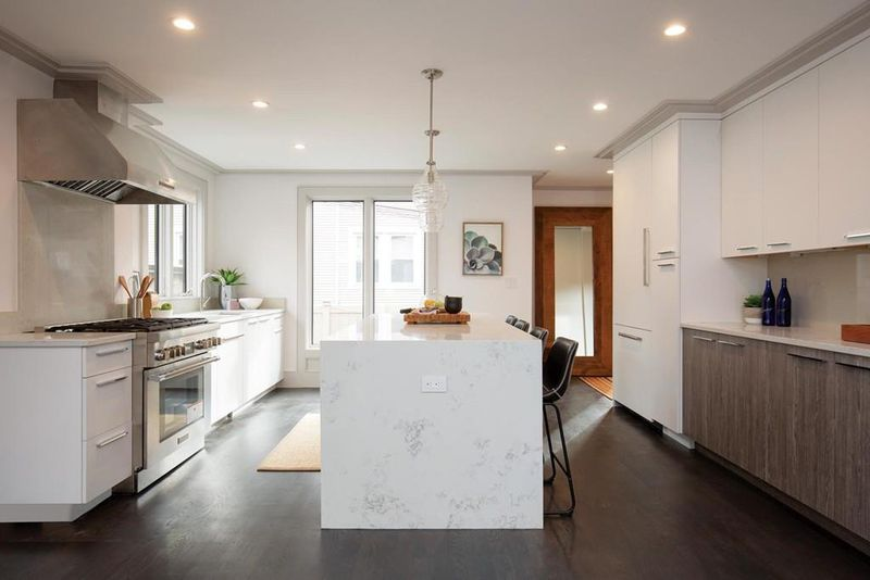 An open kitchen with a large island in the middle.