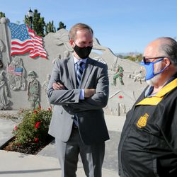 Rep. Ben McAdams, D-Utah, left, talks with Terry Schow, retired director of the Utah Department of Veterans Affairs, after McAdams discussed his bipartisan bill to prevent veteran suicides at a news conference at the Military Services Monument in West Jordan's Veterans Memorial Parkon Monday, Sept. 28, 2020. The bill, which studies the connection between living in high-altitudes and rates of suicide, passed in the House and will now go to the president for his signature.