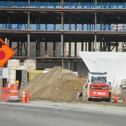 12:03 p.m. Indication that there is more excavation taking place in the plaza lot. This is the view through an open work gate, along the Clark Street side -