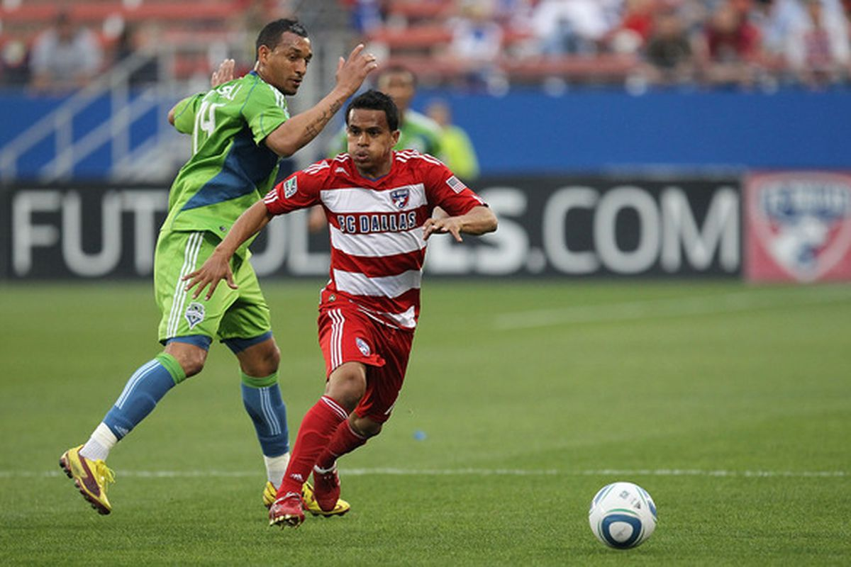 FRISCO, TX - APRIL 22:  Midfielder David Ferreira #10 of FC Dallas dribbles the ball past Tyrone Marshall #14 of the Seattle Sounders at Pizza Hut Park on April 22, 2010 in Frisco, Texas.  (Photo by Ronald Martinez/Getty Images)