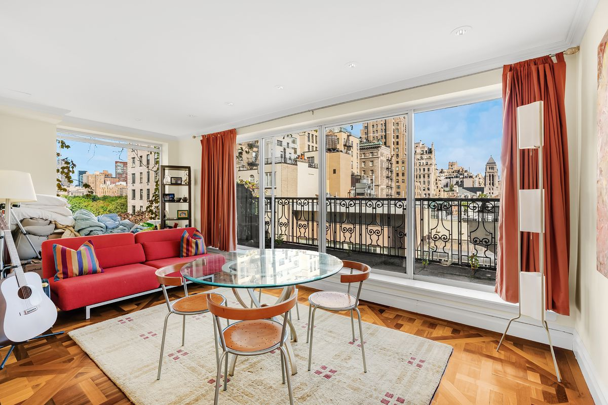The penthouse common space lets out onto a balcony overlooking the city, but also has views towards Central Park.