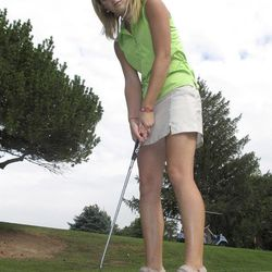 In this photo taken Thursday, Sept. 6, 2012, Sierra Harr, who helped the Castleford High School boy's golf team win Idaho's 2A championship in May, poses for a photograph while putting at the Clear Lakes Country Club near Buhl, Idaho. The Idaho High School Activities Association is mulling rule changes that could prevent the 16-year-old from golfing with the boy's team this spring.