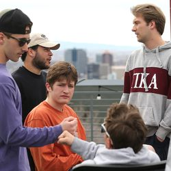 Quinn Stagg, president of Pi Kappa Alpha at the University of Utah in Salt Lake City, right, talks with fraternity brothers Kyle Lautt, left, James Bricker, Kyler Banks and Riley Elliott, at the fraternity house on Monday, March 16, 2020. Many members of the fraternity are moving out because of COVID-19.