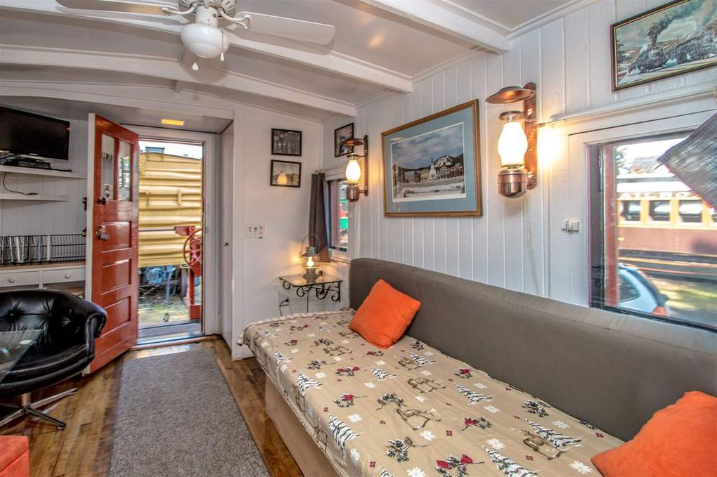 Tiny home, caboose style, can be yours for $52K - Curbed on cardboard box home designs, container home designs, carriage home designs, train car home designs, rail car dock designs,