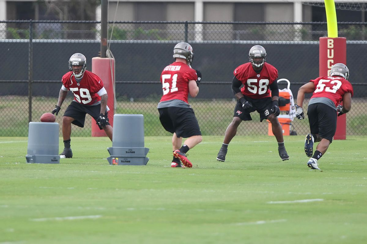 May 15, 2012; Tampa, FL, USA;  Tampa Bay Buccaneers linebacker Mason Foster (59) and linebacker Quincy Black (58) workout during organized team activities at One Buc.   Mandatory Credit: Kim Klement-US PRESSWIRE