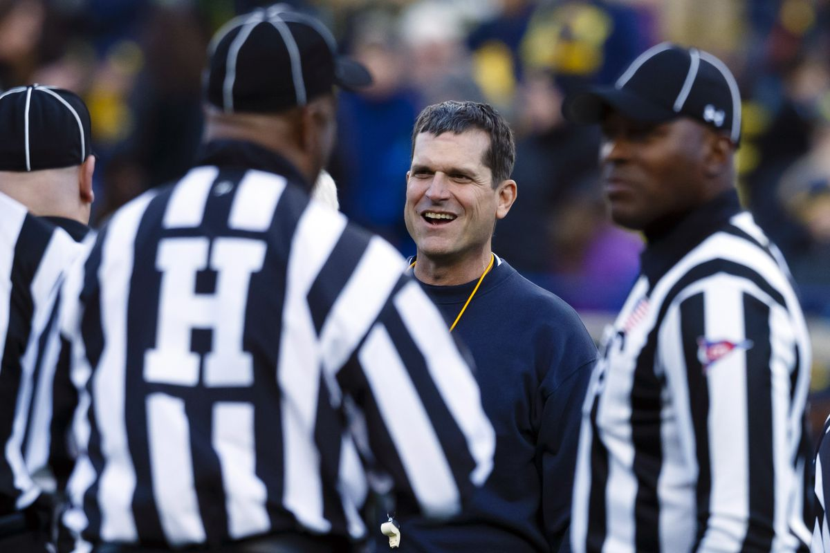 Jim Harbaugh looks on during the Michigan spring game.