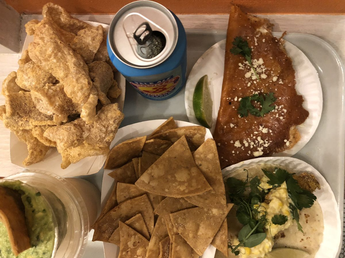 Cheese-dusted pork rinds, guacamole, mushroom tacos, and cheese tacos at Tacocina