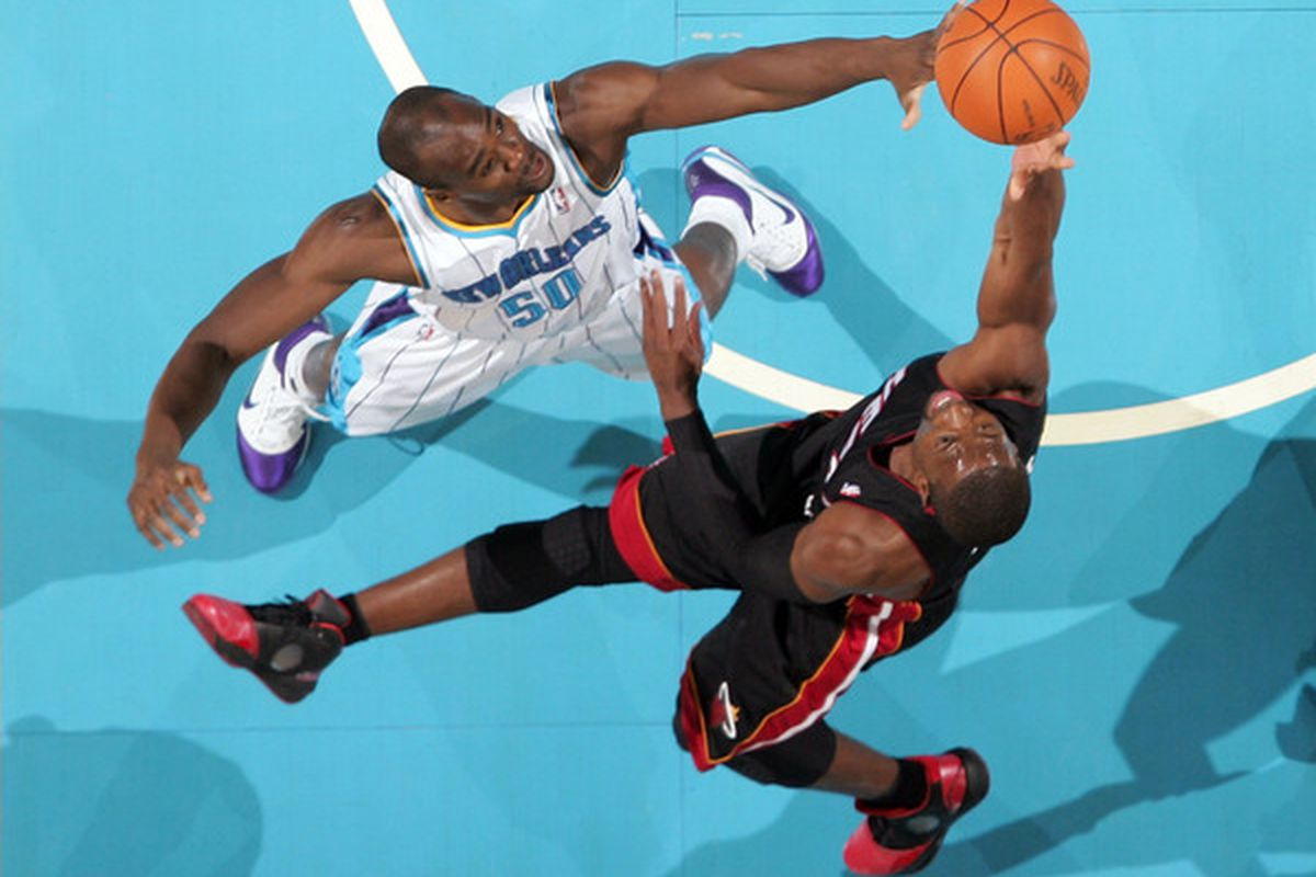 Dwyane Wade shoots the ball over Emeka Okafor at the New Orleans Arena on November 5 2010 in New Orleans Louisiana.  (Photo by Chris Graythen/Getty Images)