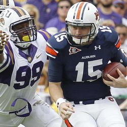 FILE - In this Oct. 22, 2011, file photo, LSU defensive end Sam Montgomery (99) reaches for Auburn quarterback Clint Moseley (15) during the first of an NCAA college football game in Baton Rouge, La., Saturday, Oct.  22, 2011.