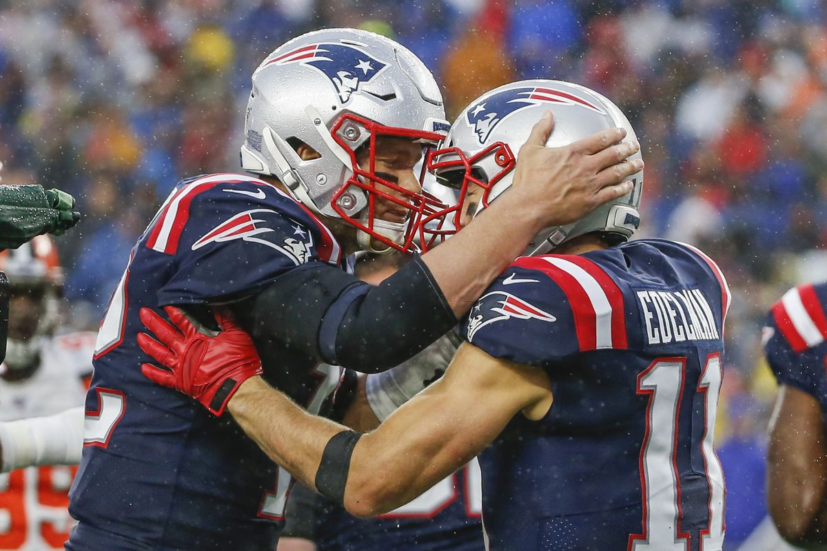 New England Patriots quarterback Tom Brady celebrates with wide receiver Julian Edelman after a touchdown during the first half against the Cleveland Browns at Gillette Stadium.
