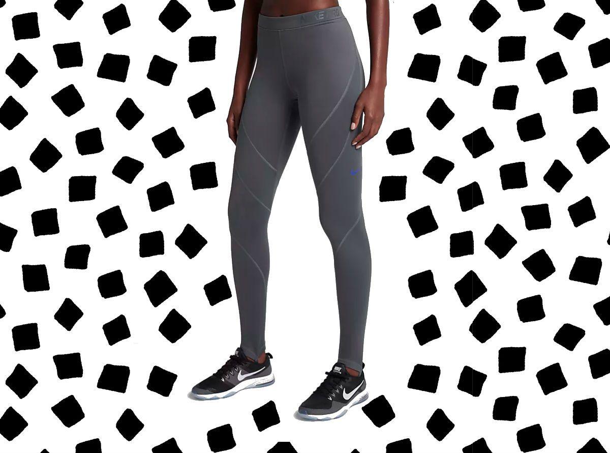A model wearing gray Nike leggings