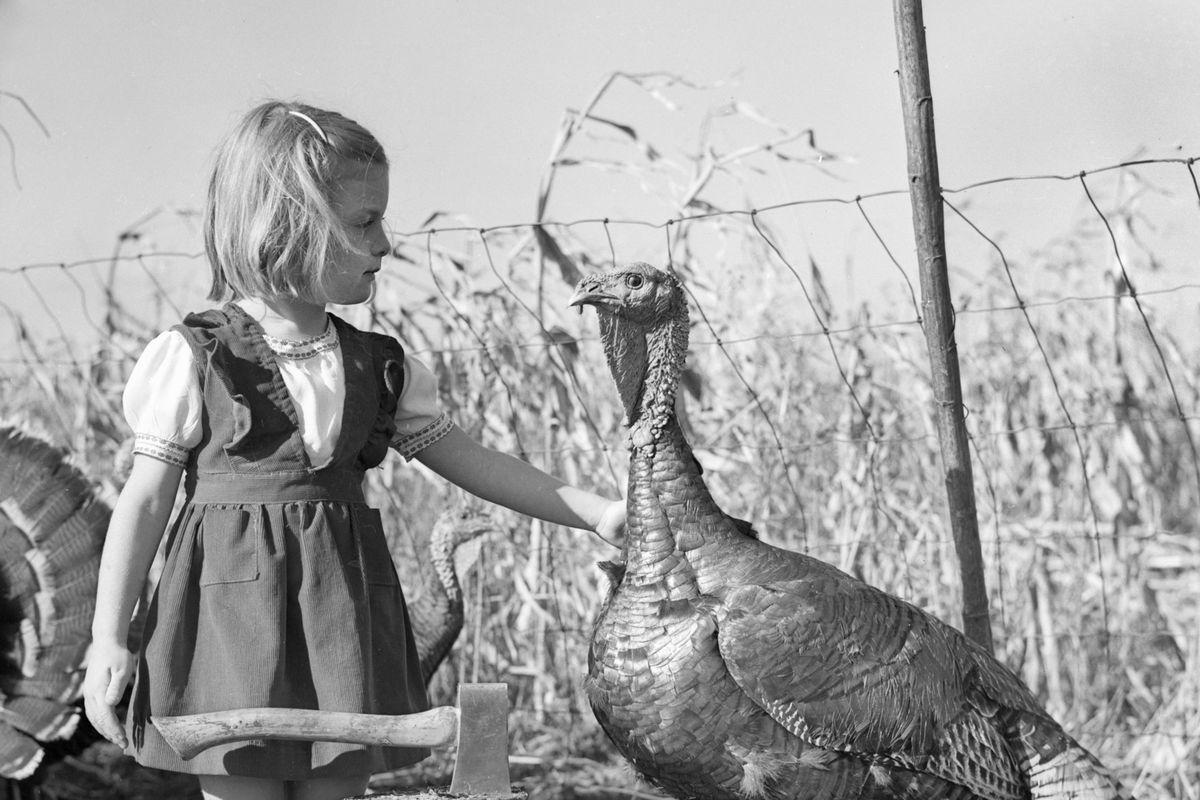 A little girl, a hatchet and a Tom Turkey, ca. 1955.
