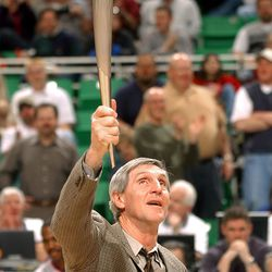 Jazz head coach Jerry Sloan has an Olympic torch presented to him by the Salt Lake Organizing Committee during halftime against the Detroit Pistons at the Delta Center on March 19, 2002.