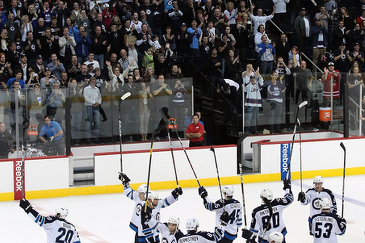 WINNIPEG, CANADA - SEPTEMBER 20: Players of the Winnipeg Jets thank their fans after defeating the Columbus Blue Jackets 6-1 at the MTS Centre on September 20, 2011 in Winnipeg, Manitoba, Canada. (Photo by Marianne Helm/Getty Images)