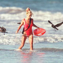 Pamela Anderson in a high leg one-piece swimsuit circa 1995.