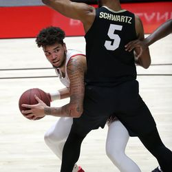 Utah Utes forward Timmy Allen (1) looks to make a pass around Colorado Buffaloes guard D'Shawn Schwartz (5) during a men's basketball game at the Huntsman Center in Salt Lake City on Monday, Jan. 11, 2021. Utah lost 58-65.