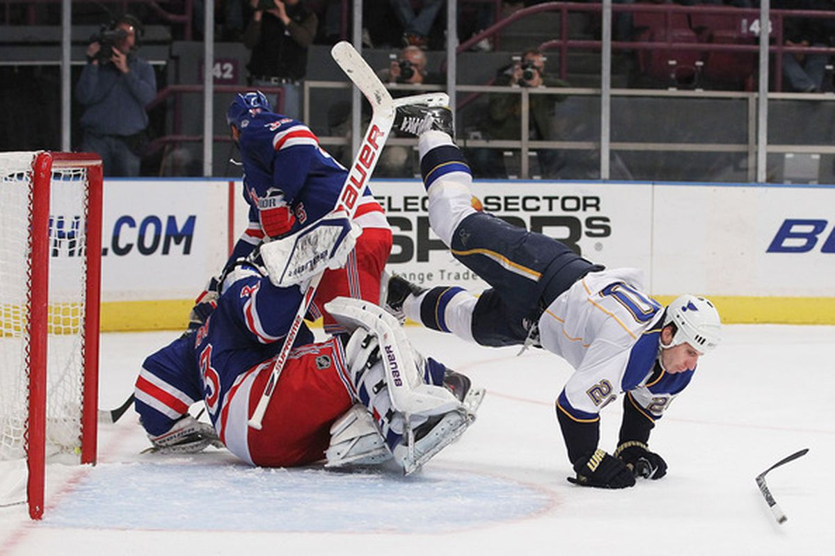 Alexander Steen (20) of the St. Louis Blues flips over Martin Biron (41) of the New York Rangers during their game on November 7 2010 at Madison Square Garden in New York City New York.  (Photo by Al Bello/Getty Images)