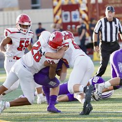 American Fork's Bodie Schoonover, shown here playing against Lehi last season, had 105 tackles, 8.5 sacks and an interception during his Caveman career. He also played tight end on offense.
