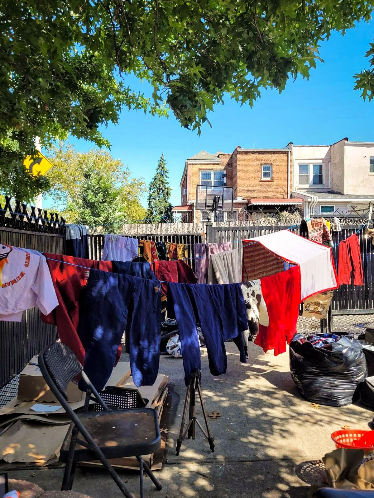 Jagpreet Singh's family and neighbors had to dry clothes, books and other belongings after their basements flooded in East Elmhurst, Queens. Sept. 2, 2021.