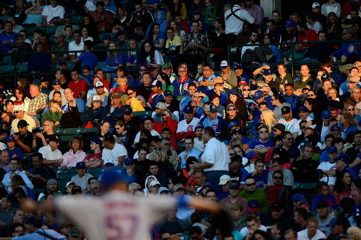 Fans watch as Johan Santana of the New York Mets pitches against the Chicago Cubs at Wrigley Field in Chicago, Illinois. (Photo by Jonathan Daniel/Getty Images)