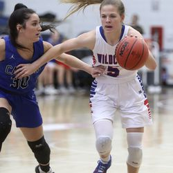 Carbon's Makenna Blanc guards Richfield's Jordyn Moon during the 3A girls basketball quarterfinals at the Lifetime Activities Center in Taylorsville on Thursday, Feb. 20, 2020. Richfield won 50-36.
