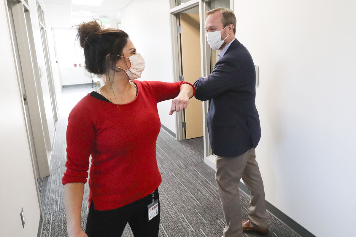 Rep. Ben McAdams, D-Utah, greets public health nurse Maria DiCaro as he visits the Salt Lake County Public Health Center in Salt Lake City on Tuesday, April 28, 2020. McAdams thanked employees who are producing vital data about the source of the county's COVID-19 infections.