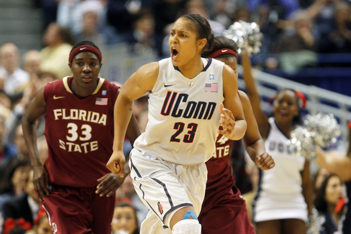 HARTFORD CT:  Maya Moore #23 of the Connecticut reacts in the final minutes of a win over Florida State in Hartford Connecticut.  Connecticut set a record with 89 straight wins without a defeat. (Photo by Jim Rogash/Getty Images)