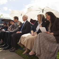 Carri Jenkins, right, and Dottie Orme huddle under an umbrella during the groundbreaking ceremony for a new engineering building at BYU in Provo on Monday, May 9, 2016. The new building was entirely funded by donors.