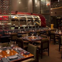 A view from the dining room toward the bar at Gordon Ramsay Steak.