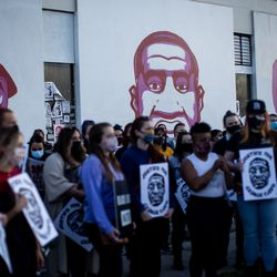 People demonstrate in front of a mural in Salt Lake City of George Floyd and others killed by police after a jury found former Minneapolis police officer Derek Chauvin guilty in the killing of George Floyd on Tuesday, April 20, 2021.