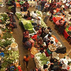 Villagers buy vegetables at the colorful Chichicastenango market, 87 miles west of Guatemala City..
