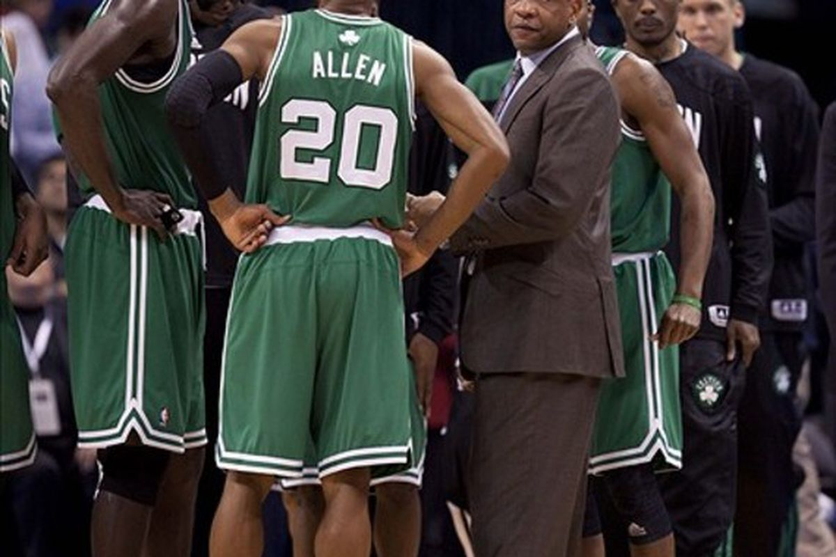 Feb 22, 2012; Oklahoma City  OK, USA; Boston Celtics head coach Doc Rivers in a team huddle during the fourth quarter against the Oklahoma City Thunder at Chesapeake Energy Arena Mandatory Credit: Richard Rowe-US PRESSWIRE